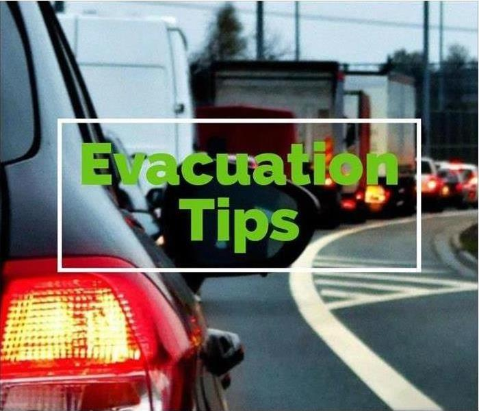 "A line of cars in traffic during evacuation with ""Evacuation Tips"" labeled across the photo."
