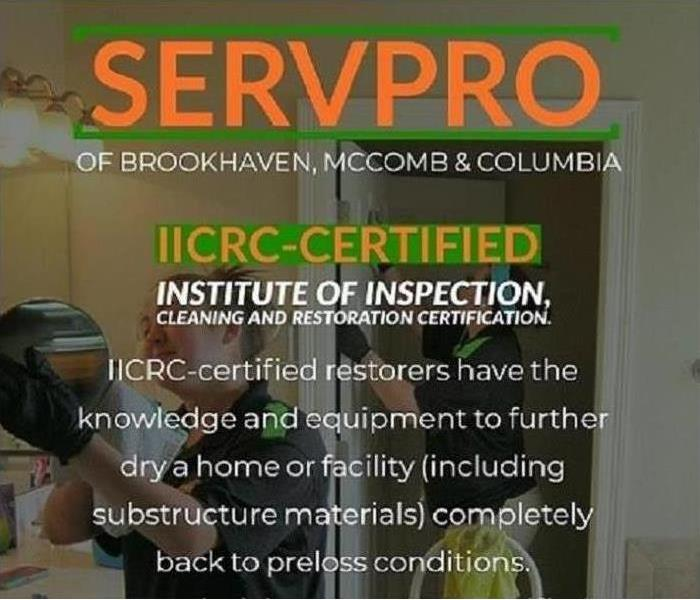 An image of Brookhaven SERVPRO workers cleaning with text across the image saying we are IICRC-certified.